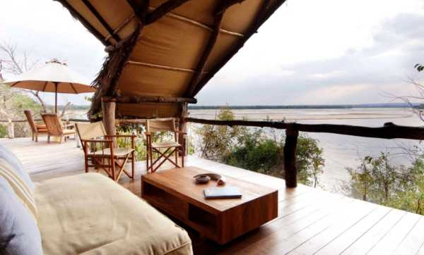The Rufiji River flows past the open-fronted rooms at Sand Rivers Selous