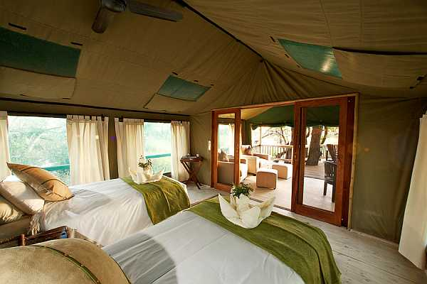 Gunns Camp luxury twin tent Okavango Delta