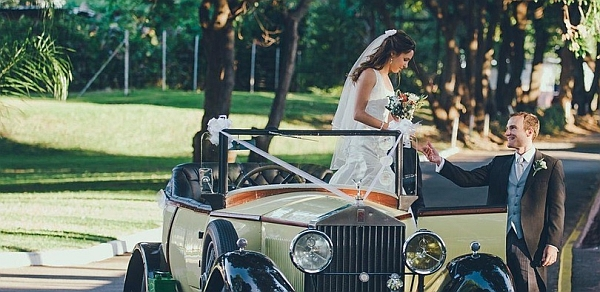 The River Club bride getting out of vintage car - Weddings at Victoria Falls